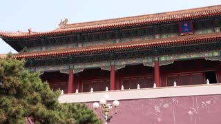 people near the forbidden city wall