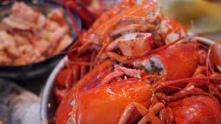 People prepare lobster for their dinner