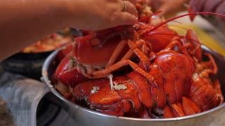 People preparing lobster for dinner