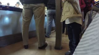 People standing in line at food restaurant