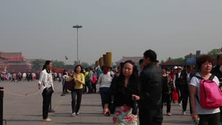 people taking photos in tiananmen square china