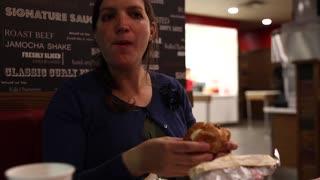 pregnant woman eating fast food hamburger