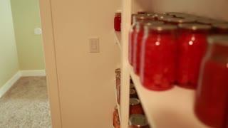 preserved food in jars in storage room rack focus