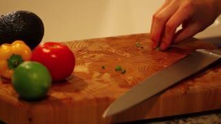 putting green onion on salad