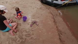 rafts and families on the san juan river in a dry desert