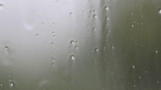 Rain running down window during storm