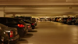 Really full underground parking garage with cars