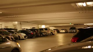 Really full underground parking garage with lots of cars