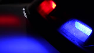 Red and Blue Police Lights at Night