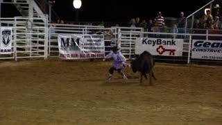 Rodeo clowns fight bull