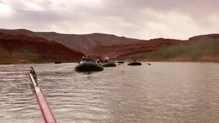 rowing down a river in boats
