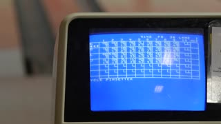 Screen shows bowling scores of game at bowling alley