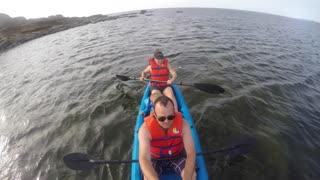 Shot of a couple on sea kayak on ocean