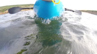 Shot of sea kayak on surface of ocean
