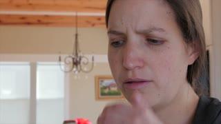Sick woman blows nose in kleenex