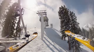 skis geting off chair lift