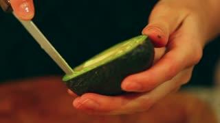 slicing an avacado for salad