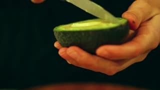 slicing an avacado