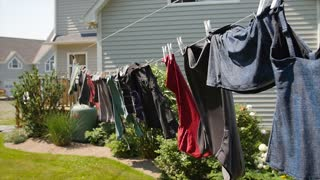 Slow motion clothes drying on a line blowing in a wind