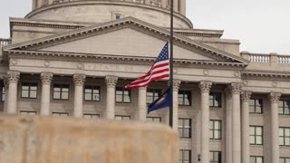 Slow Motion Dolly shot of flags at the Utah State Capitol Building