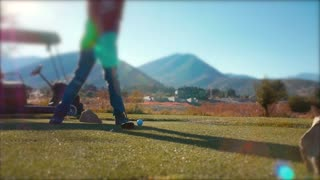 Slow motion man playing golf on the golf course