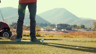Slow motion of boy playing golf on the golf course