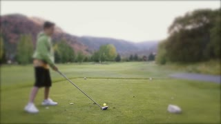 Slow motion of driving a golf ball on the course