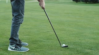 Slow motion of man driving a golf ball with his club