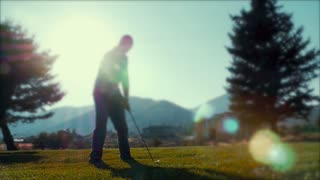 Slow motion of man hitting the golf ball on the golf course