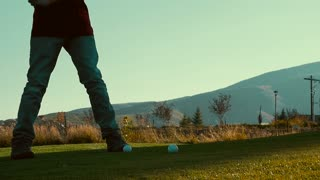 Slow motion of teen hitting the golf ball on the golf course