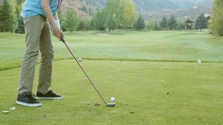 Slow motion of teen missing golf ball on the course