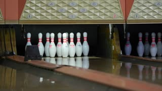 Slow motion shot of a bowling ball hitting pins