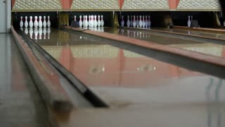 Slow motion shot of ball hitting the bowling pins