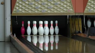 Slow motion shot of bowling ball hitting a pin
