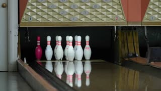 Slow motion shot of bowling ball hitting pins