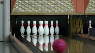 Slow motion shot of bowling ball missing pins