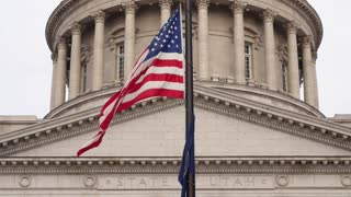 Slow motion shot of the flags at Utah State Capitol Building