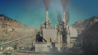 Smoke billowing out of smoke stacks at coal plant