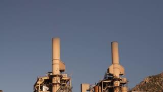 Smoke stacks at industrial coal mining plant