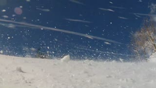 snow falling down mountainside at resort