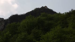 the great wall of china tower on mountain ridge