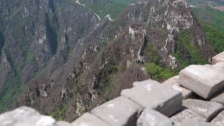 the jiankou section of the great wall of china on a mountain ridge
