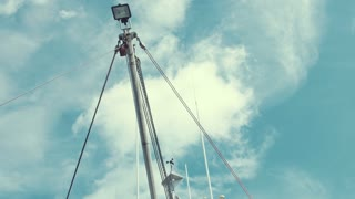 The mast of a large fishing boat in the ocean