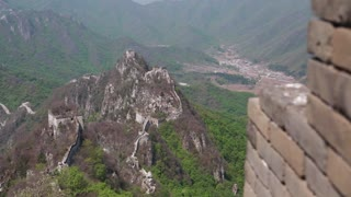 the towers of the great wall of china on a mountain ridge