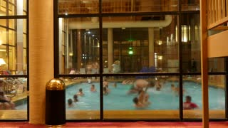 TImelapse of people swimming in a pool