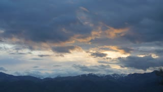 Timelapse storm clouds above mountain range