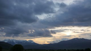 Timelapse storm clouds over mountain range
