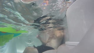 Timelapse underwater shot of a family in a clean hot tub