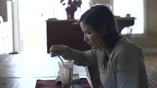 Tired woman drinking health shake for breakfast