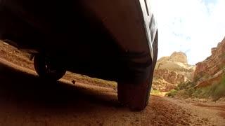 tires kicking up mud